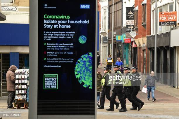 A group of police officers patrol Briggate in central Leeds on the morning of March 21 a day after the British government said it would help cover...