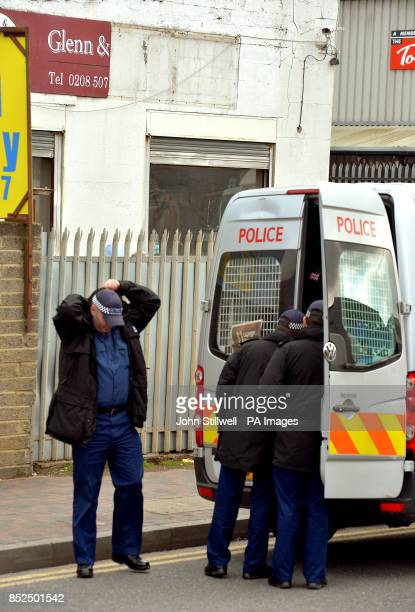 A group of Police Officers prepare to search the road outside the Glen Cash Carry warehouse in Barking Essex where during a robbery yesterday the...
