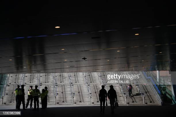 Group of police officers secure the area at the bottom of the steps from the London Underground station for Wembley Stadium ahead of the English FA...