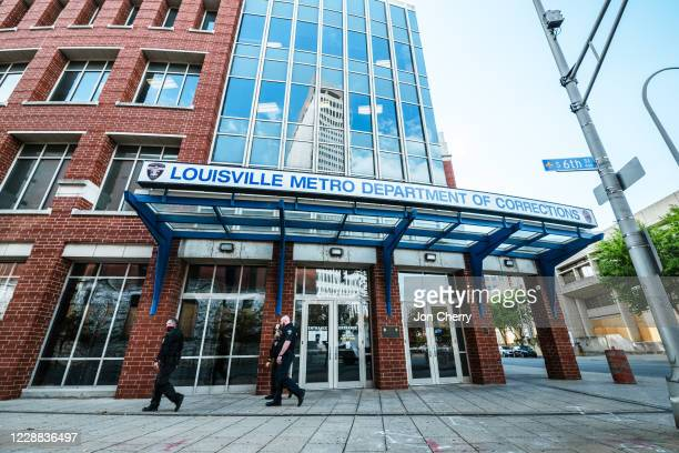 Group of police officers walk by the Louisville Metro Department of corrections, which sits adjacent to Jefferson Square Park on October 1, 2020 in...