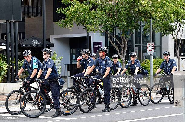 A group of Police patrolling the streets on push bikes are seen just near the Brisbane Convention Exhibition Centre which is the host venue on...
