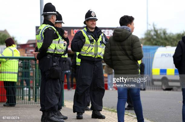 A group of police watch on as Newcastle United fans arrive before kick off of the Sky Bet Championship match between Cardiff City and Newcastle...