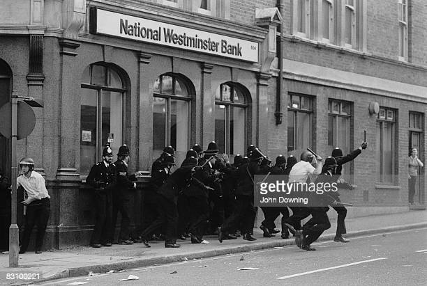 A group of policemen outside a National Westminster Bank during the Brixton Riot of 11th April 1981