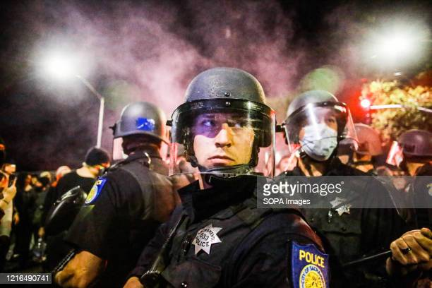 Group of policemen stand, surrounded by protesters during the demonstration. A peaceful protest, spurred by the death of George Floyd, turned violent...