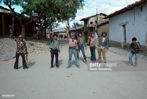 A group of Popular Forces of Liberation guerrillas pose on a road in Santa Anita Chalatenango department El Salvador February 23 1981 At the time the...