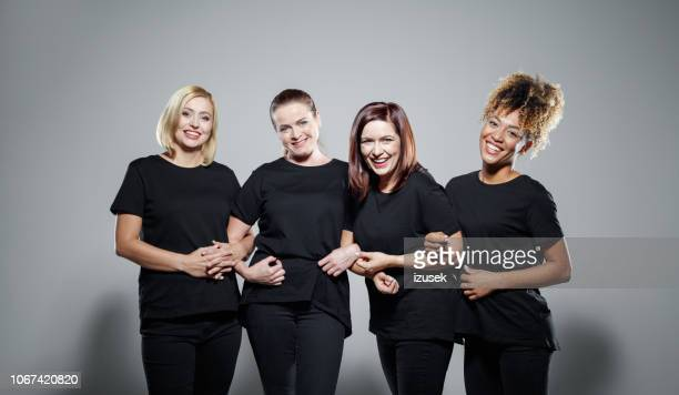 group of powerful women - arm in arm stock pictures, royalty-free photos & images
