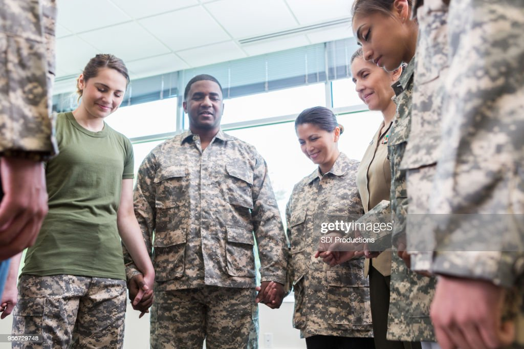Group of praying army soldiers : Stock Photo