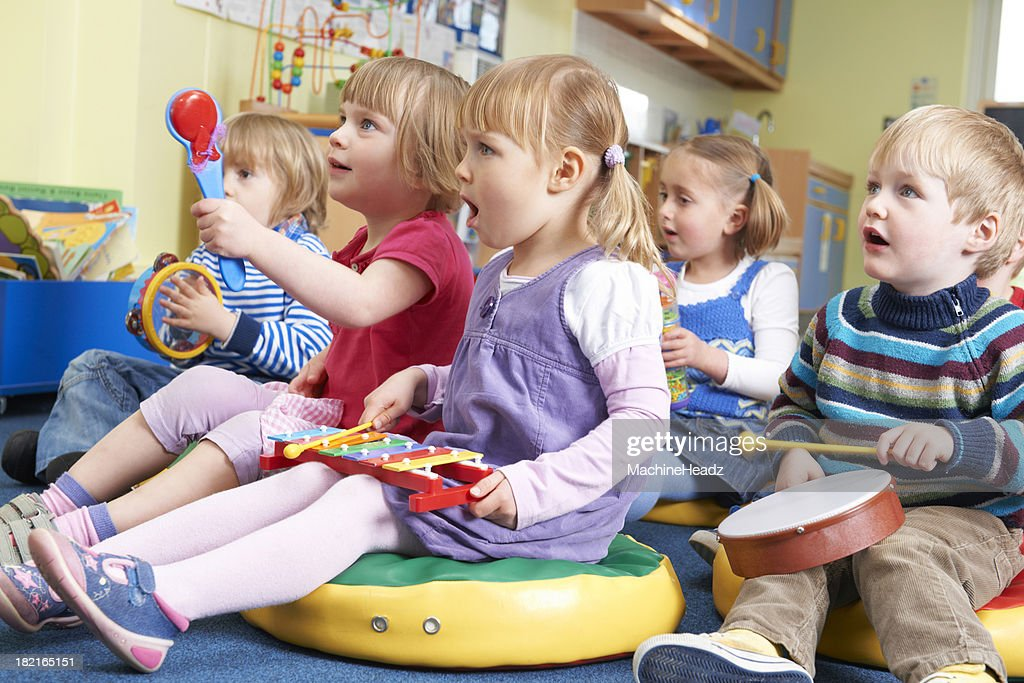 Group Of Pre School Children Taking Part In Music Lesson : Stock Photo