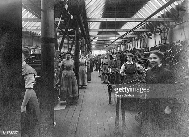 A group of predominantly female factory workers circa 1900