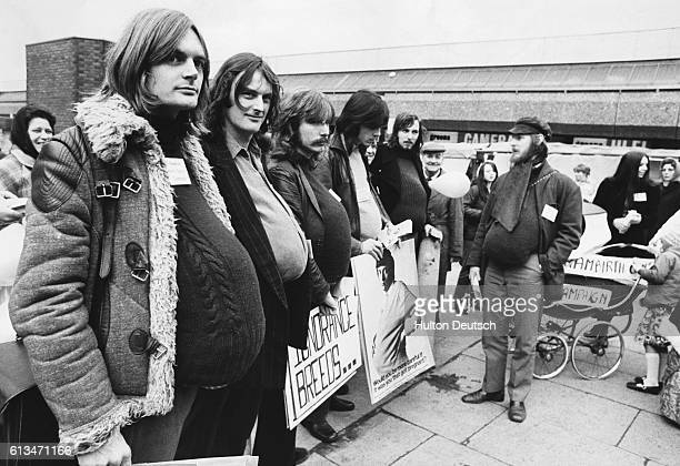 A group of 'pregnant men' at a demonstration at Queen's Road market as part of a birth control campaign England 1972 | Location Queen's Road market...