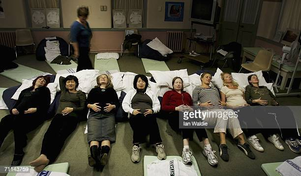 A group of pregnant women perform relaxation techniques during a prenatal class at Royal North Shore Hospital June 7 2006 in Sydney Australia...