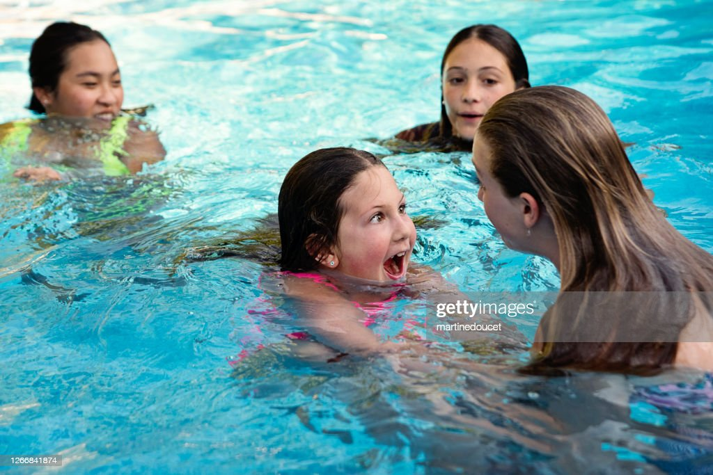 Group of preteen and teenage girls in pool. : Stock Photo