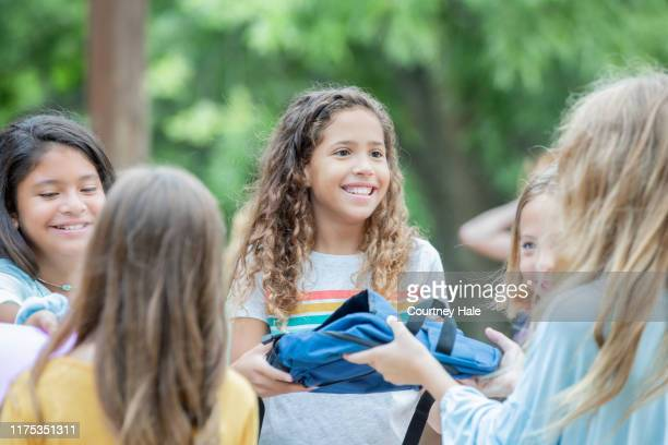 group of preteen students collecting school supply donations during volunteer event - charity benefit stock pictures, royalty-free photos & images