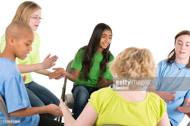 group of pre-teens children playing a game in circle - alina stock pictures, royalty-free photos & images