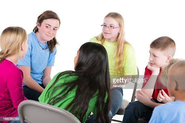 Group of pre-teens children talking in a circle