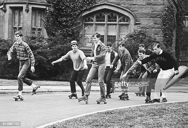 Group of Princeton students engage in the nation's newest college fad: skating to classes. | Location: Princton, New Jersey, USA.