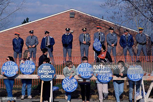 A group of prochoice supporters outside an abortion clinic during an abortion rights rally in Buffalo The demonstrators surrounded by police officers...
