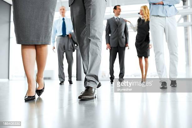 Group of professionals walking in a building