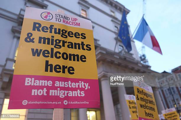 A group of promigrant demonstrators demonstrators hold a protest outside the French embassy in London on 24 October 2016 to protest agaist the...