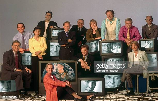 A group of prominent French journalists gather around stacks of television sets Pictured are MarieLaurie Aubry Emmanuel Chain Claire Chazal Guillaume...