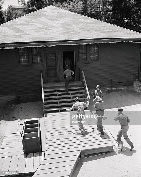 A group of ProNazi war prisoners at the temporary internment camp on Angel Island answer mess call just as anybody else would Note that two of them...