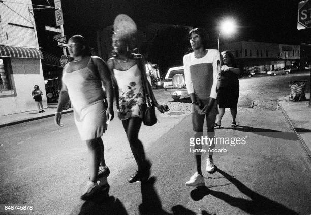 A group of prostitutes including Sugarbear and Charisse both on the left walk through the meatpacking district in New York City in Sept 1999