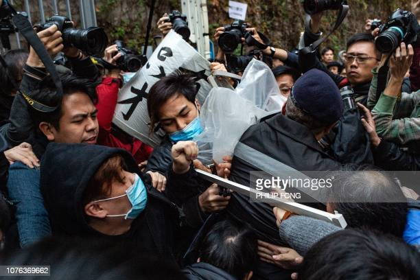 A group of protesters and security guards clash outside the government complex during the annual New Year's Day prodemocracy rally in Hong Kong on...