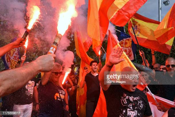 Group of protesters from the far right with coloured flares while saluting the Nazi way, during the demonstration. Some 200 people from different...