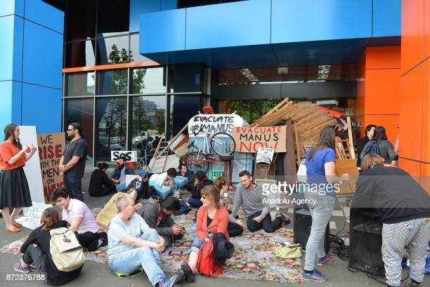 A group of protesters gather in Melbourne to urge the Australian government to end the refugee crisis on Manus Island on November 10 2017