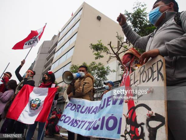 Group of protesters haranguing when on the day of Pedro Castillo's presidential inauguration his supporters take to the streets to demand a new...