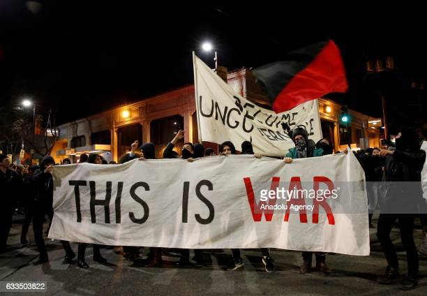 A group of protesters hold a banner reading 'This is war'at Sproul Hall in Berkeley California United States on February 2 2017 Protesters prevent...