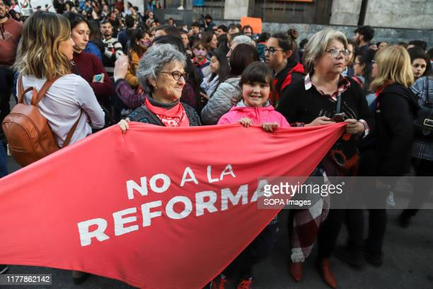 Group of protesters hold a flag during the no to the reform march in Montevideo. People march against the constitutional reform project which...