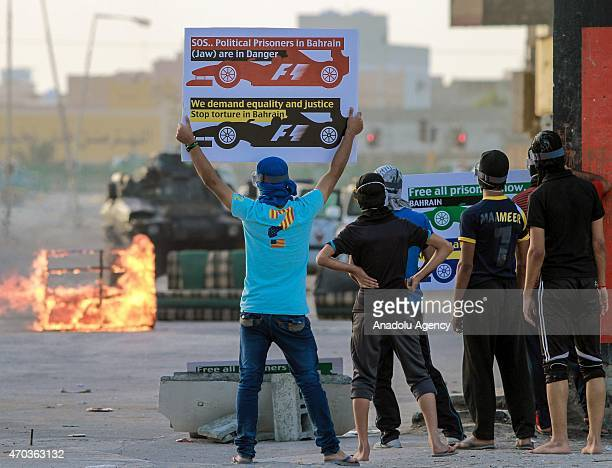 Group of protesters hold banners and placards demanding the cancellation of Formula 1 races which is being held in Manama as they stage an...