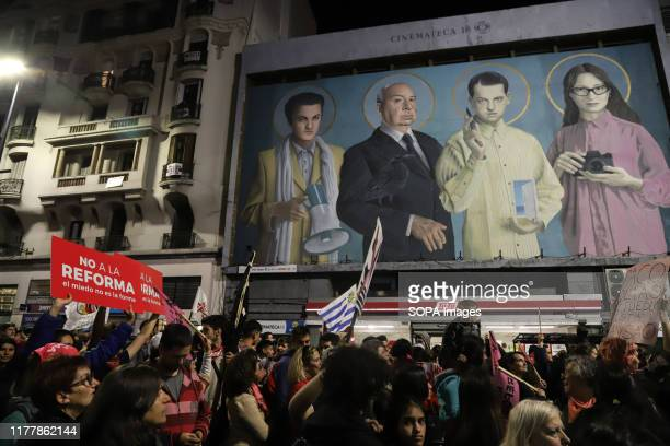 Group of protesters march on the street during the no to the reform rally in Montevideo. People march against the constitutional reform project which...