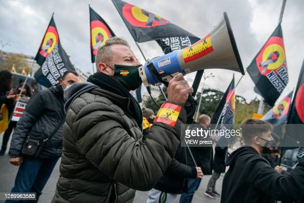 """Group of protesters march with Spanish flags and banners against illegal immigration on December 7 in Madrid, Spain. With the slogan """"frente a su..."""