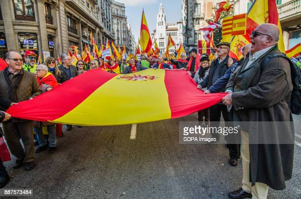 A group of protesters seen carrying a large Spanish flag Spain celebrates today the 39 anniversary of its Constitution This year the celebration...