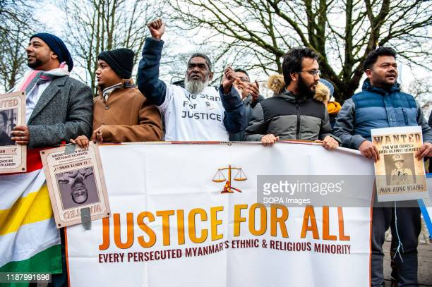 Group of protesters shout slogans while holding a banner and placards during the demonstration. Hundreds of people from The European Rohingya Council...