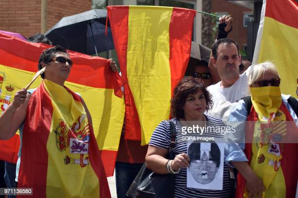 A group of protesters with flags of Spain in front of the headquarters of the Public Television of Catalonia Hundreds of people fans and groups of...