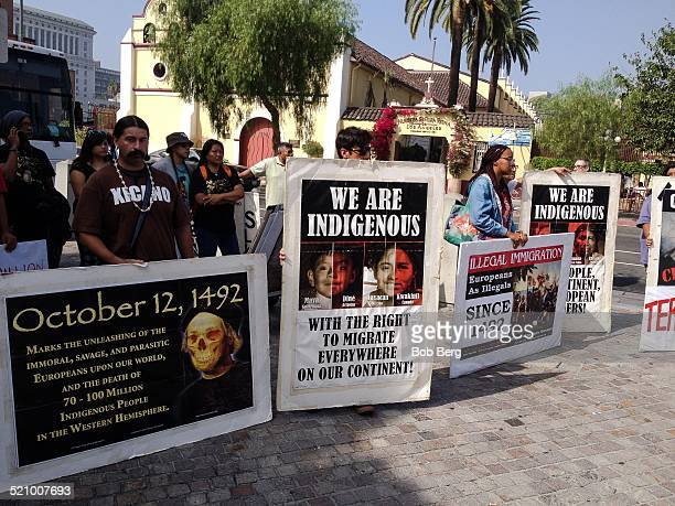 A group of protesters with their protest signs at the Protest and March Against Columbus Sunday October 12 2014 in Los Angeles