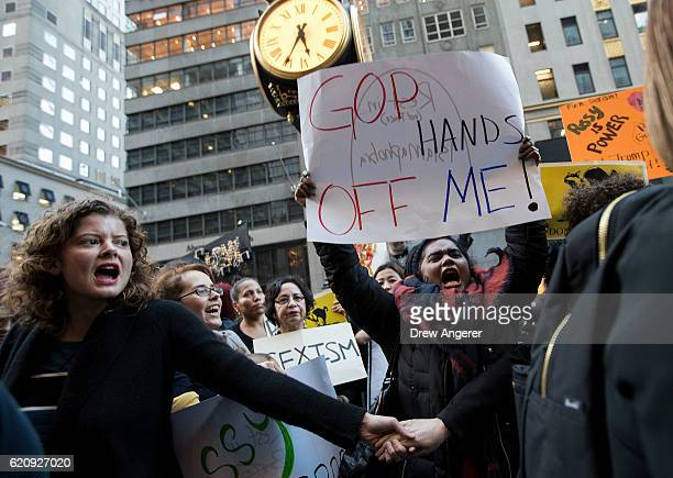 A group of protestors comprised mostly of women rally against Republican presidential candidate Donald Trump outside of Trump Tower November 3 2016...