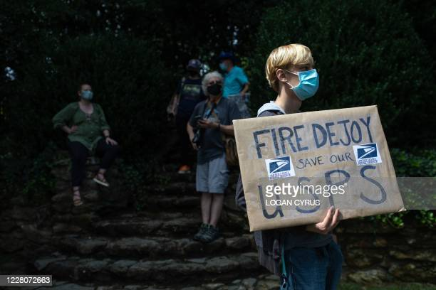 Group of protestors hold a demonstration in front of Postmaster General Louis DeJoy's home in Greensboro, North Carolina on August 16, 2020. - DeJoy...
