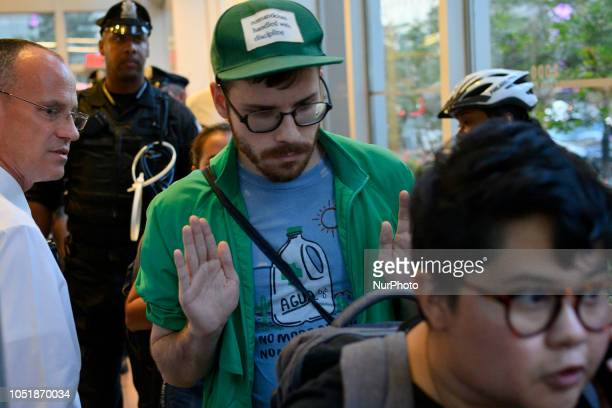 A group of protestors leave voluntarily after blocking the entrance to the lobby of the Center City office of Sen Bob Casey in Philadelphia PA on...