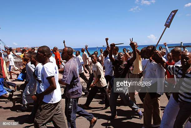A group of protestors march towards the French embassy on March 27 2008 demanding that ousted rebel leader Mohamed Bacar be sent back to face trial...