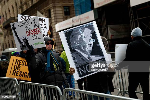 A group of protestors rally against Presidentelect Donald Trump outside of Trump Tower December 15 2016 in New York City Presidentelect Donald Trump...