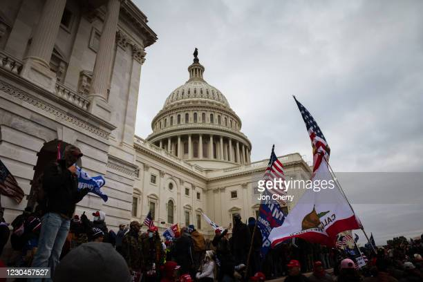 Group of pro-Trump protesters are seen on the West end of the grounds of the Capitol Building on January 6, 2021 in Washington, DC. A pro-Trump mob...