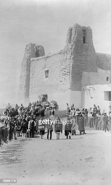 A group of Pueblo Indians from the Native American village of Acoma gather at the Saint Esteban del Rey mission in New Mexico to observe a feast day