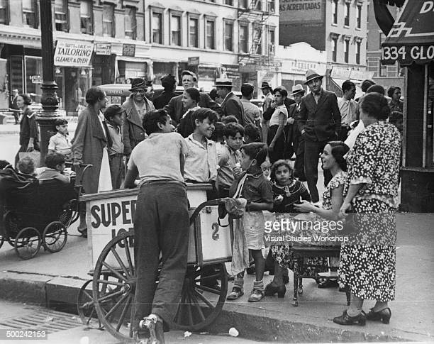 Group of Puerto Rican children gather on street corner for ice cream, New York, New York, early to mid 20th century.