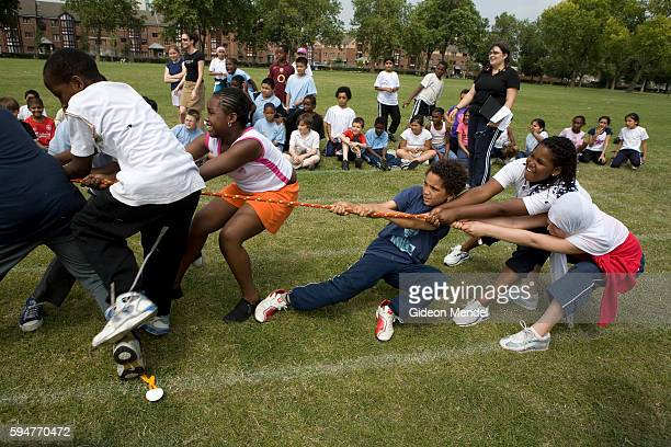 A group of pupils from Millfields Community School are pulled over as they lose a tugofwar contest during their school sports day held in a local...