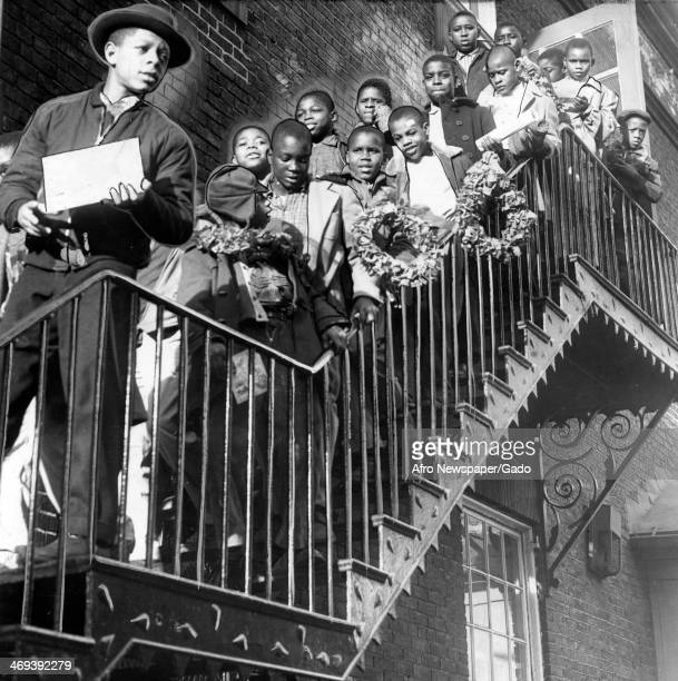 Group of pupils on a stairway outside school leaving on the last day before the Christmas holidays, Baltimore, Maryland, January 2, 1957.