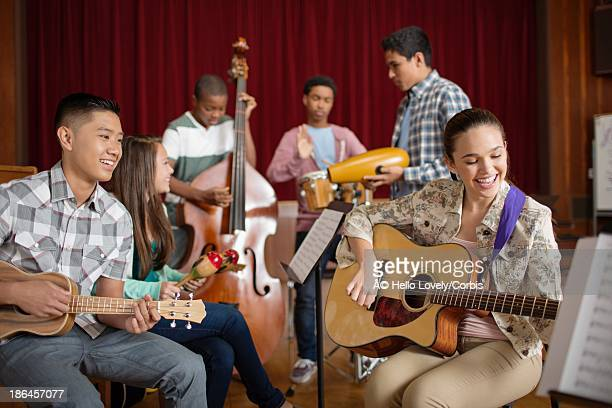 Group of pupils (16-17) playing musical instruments
